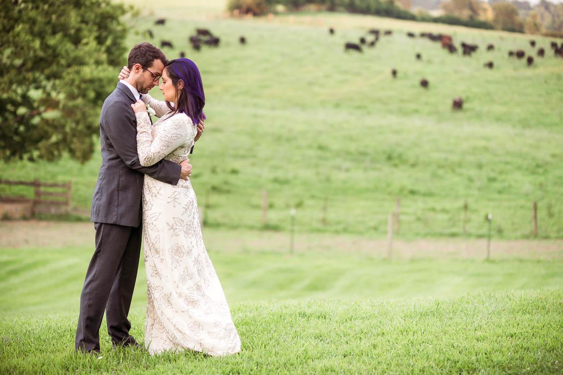 Wedding couple in a field.